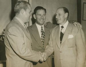 Mel Ott embraces team president Horace Stoneham and new skipper Leo Durocher on the day he announced his resignation as manager of the New York Giants.