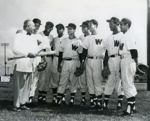 Scout Joe Cambria with several of his discoveries—Pedro Ramos, Carlos Paula, Julio Becquer, Camilo Pascual, Gil Hooker and Jose Valdivieso. When Carlos Paula made his major league debut at Griffith Stadium on September 6, 1954, he became the first black player in Washington Senators history.